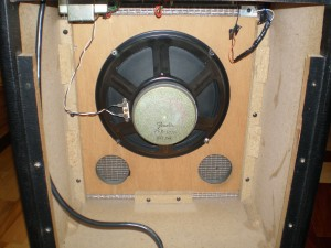 Cabinet back removed, showing the back of the speaker